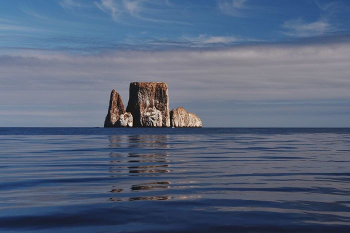 EyeEm Selects Sea Water No People Outdoors Stack Day Horizon Over Water Sky Island Rock Kicker Rock Galapagos Galapagos Islands Reflection Reflection On Water