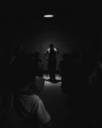People in illuminated room