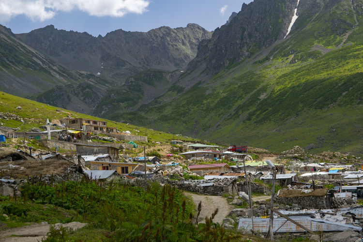 Aerial view of townscape by mountains
