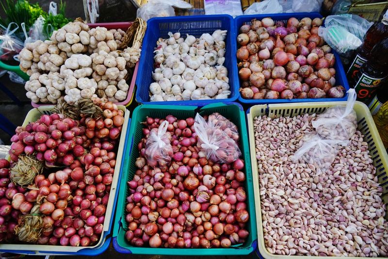 Large Group Of Objects For Sale Food And Drink Variation High Angle View Choice Market Food Retail  Freshness No People Outdoors Business Finance And Industry Morning Market Thailand Local Market Day Healthy Eating Asian Market Garlic Onions Food Stories