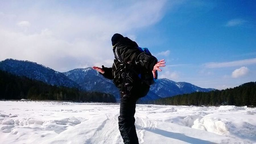 Person with arms outstretched in snow