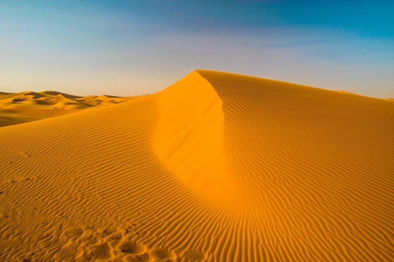 EyeEm Selects Desert Sand Dune Arid Climate Landscape Climate Scenics - Nature Remote Beauty In Nature Tranquil Scene No People Environment Non-urban Scene Sky Land Tranquility Nature Day Clear Sky Barren Sand