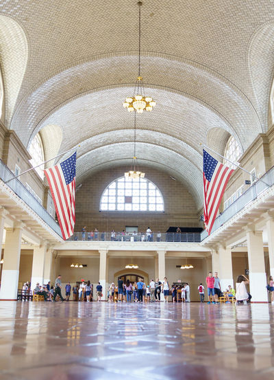 Ellis Island  Immigration New Jersey New York New York City Sightseeing Statue Of Liberty USA Adult America Arch Architecture Built Structure Day Famous Place Flag History Indoors  International Landmark Large Group Of People Patriotism People Real People Registration Registration Hall Travel Travel Destinations