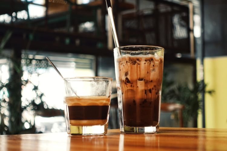 Close-up of coffee in glass on table