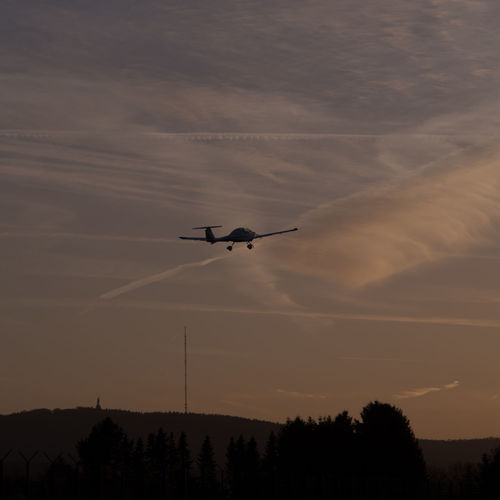 Starting airplane at sunset Airplane Beauty In Nature Clouds And Sky Evening Light Evening Sky Evening Walk Hermannsdenkmal Memorial No People Outdoors Silhouette Sunset Transmission Tree Vapor Trails Vapor Trails In The Sky At Sunset