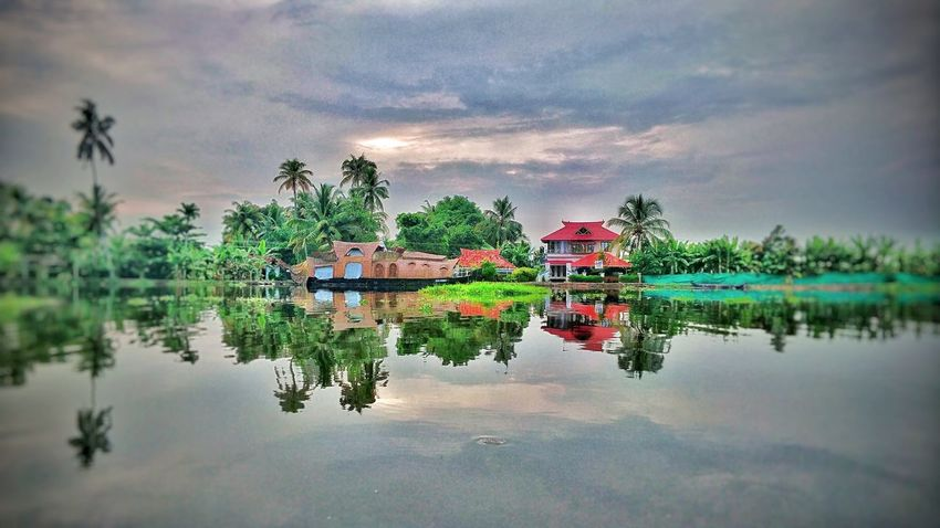 Nature at its own style.. A stunning view of gods own country.. Water Reflection River River View Riverside Kerala India Houseboat Aleppy Mountain