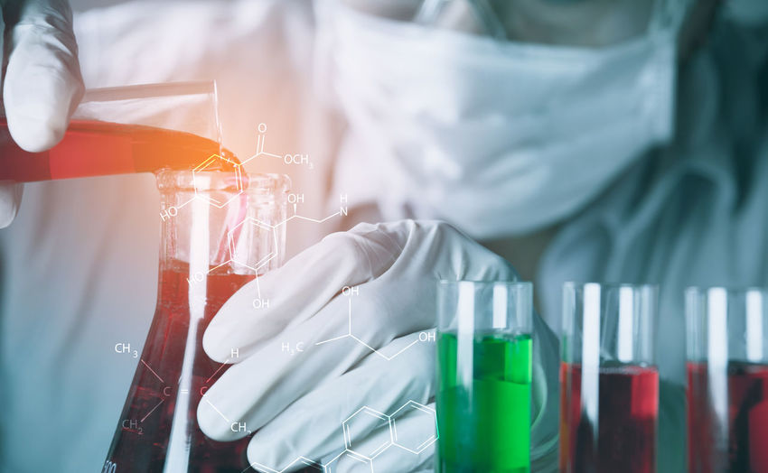Analyzing Close-up Education Equipment Focus On Foreground Healthcare And Medicine Indoors  Laboratory Midsection Occupation One Person Protection Protective Glove Protective Workwear Real People Research Safety Science Scientific Experiment Security Surgical Glove