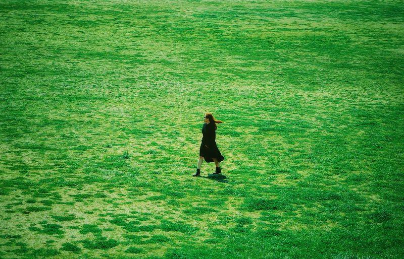 Full length of woman walking on grass