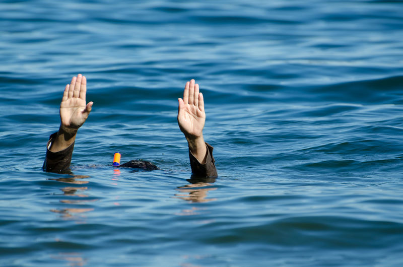 Woman Underwater with Raised hands Adult Creativity Humor Sunny Woman Body Part Day Finger Hand Help Human Body Part Human Hand Lake Nature One Person One Woman Only Outdoors People Raised Hands Real People Sea Underwater Water Waterfront