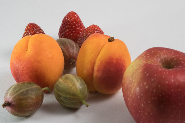 Some Fruit Apple Apricots Close-up Day Food Food And Drink Freshness Fruit Fruit And Vegetable Gooseberries Healthy Healthy Eating Indoors  No People Still Life Strawberries Studio Shot White Background
