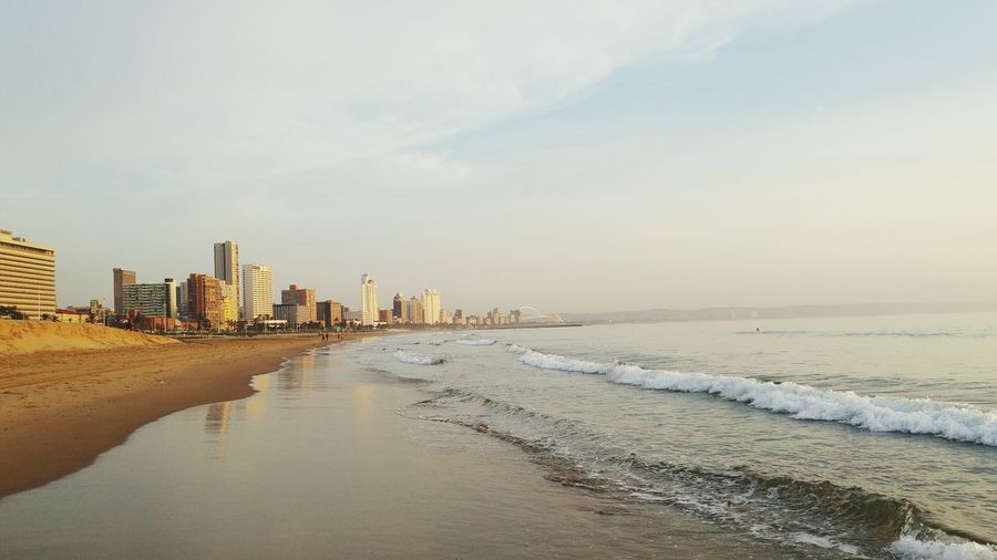 Sunrise in Durban Durban Beachfront New Day Rising Sunrise_Collection Aprilphotochallenge Beach Walk Durban South Africa Cityscapes Sea Sea And Sky Sea Side City Skyline No People Lost In The Landscape