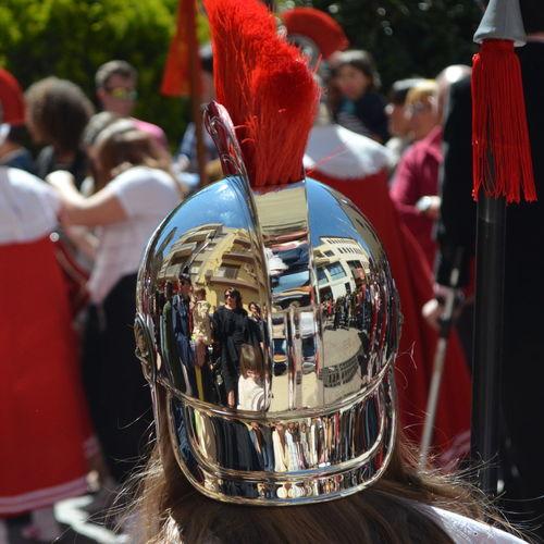 Reflection Of People On Metal Helmet