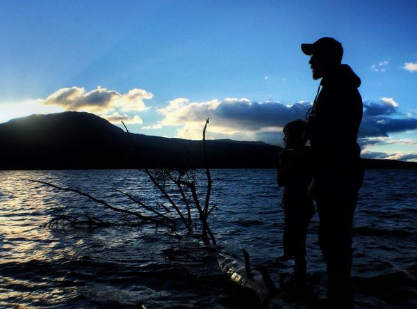 Father and son. Mountain Water Silhouette Lake Tranquil Scene Scenics Sky Vacations Tranquility Mountain Range Cloud Beauty In Nature Nature Cloud - Sky Getting Away From It All Remote Calm Tourism Waterfront Non-urban Scene People And Places