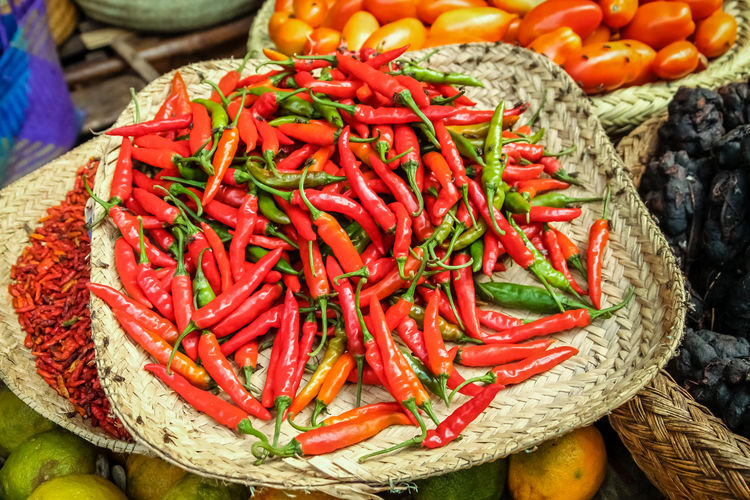 Close-up of red chili peppers in basket at market