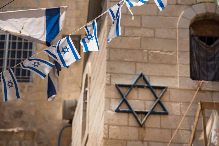 The flag of Israel blowing in the wind. Star of David Country Independence Israeli Israeli Flag Jew Jewish Jewish Star Patriotism Star Of David Zion Architecture Blue Building Building Exterior Built Structure Day Flag Flag In The Wind Hanging Israel Israelinstagram No People Outdoors State Symbol
