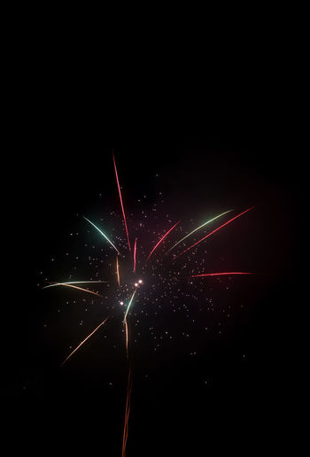 Night Illuminated Motion Celebration Firework Long Exposure Arts Culture And Entertainment Firework Display Event Glowing Blurred Motion Sky Copy Space No People Black Background Red Exploding Multi Colored Nature Firework - Man Made Object Sparks Silvester New Year's Eve