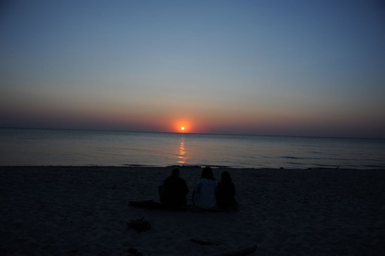 Beach Beauty In Nature Darßwald Family Watching Sunset Family With One Child Horizon Over Water Leisure Activity Men Nature Outdoors Real People Sand Scenics Sea Silhouette Sky Sun Sunset Togetherness Tranquil Scene Tranquility Water Weststrand