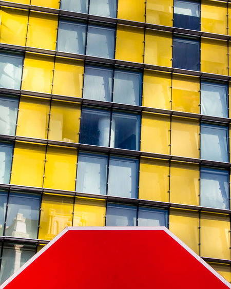 Architecture Backgrounds Building Building Exterior Built Structure City Close-up Day Full Frame Low Angle View Modern Multi Colored No People Outdoors Red Window Yellow The Graphic City