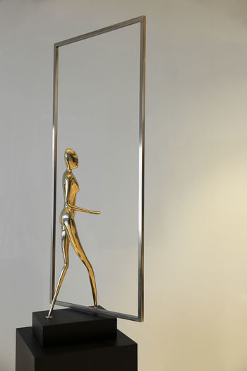 Architecture Art And Craft Copy Space Craft Creativity Frame Gilded Gold Gold Colored Human Representation Indoors  Low Angle View Metal Museum No People Picture Frame Representation Sculpture Shape Statue Wall - Building Feature