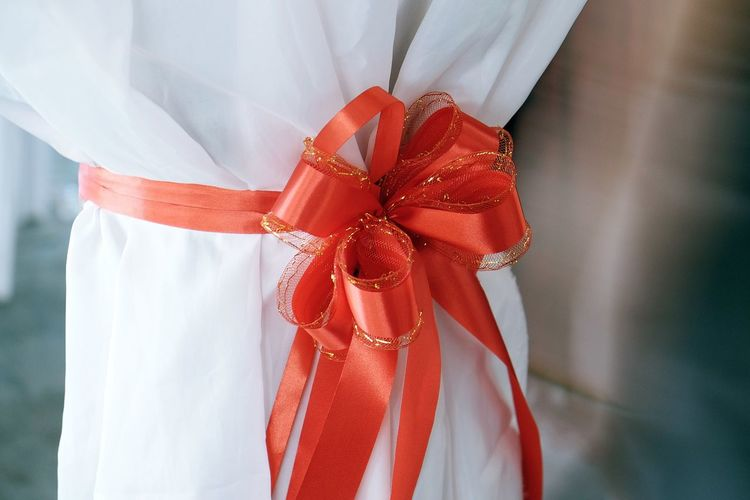 Close-up Day Low Section Midsection One Person Outdoors Real People Red Standing Tied Bow