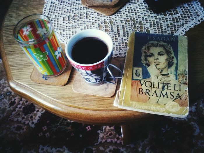 Mixed smells of fresh cup of coffee and old book ☕📖 Glass Of Water Book Books Old Book Smell Coffee Table Drink Close-up Black Coffee Coffee Beverage Coffee Cup Hot Overhead View Cup Coffee - Drink