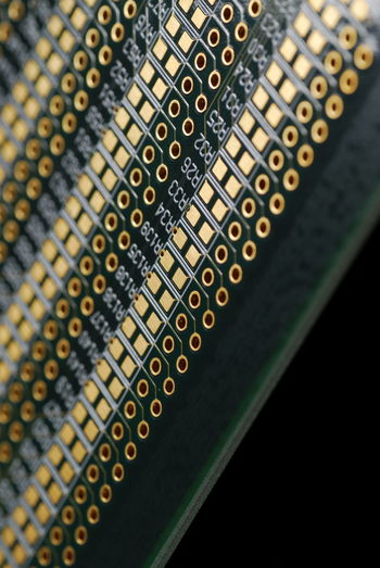 Close-up of circuit board against black background