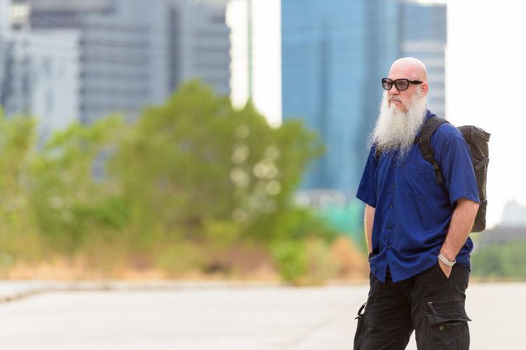 Man wearing sunglasses standing outdoors