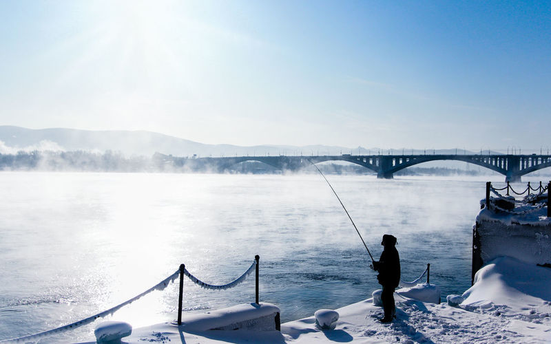 Scenic view of bridge over river during winter