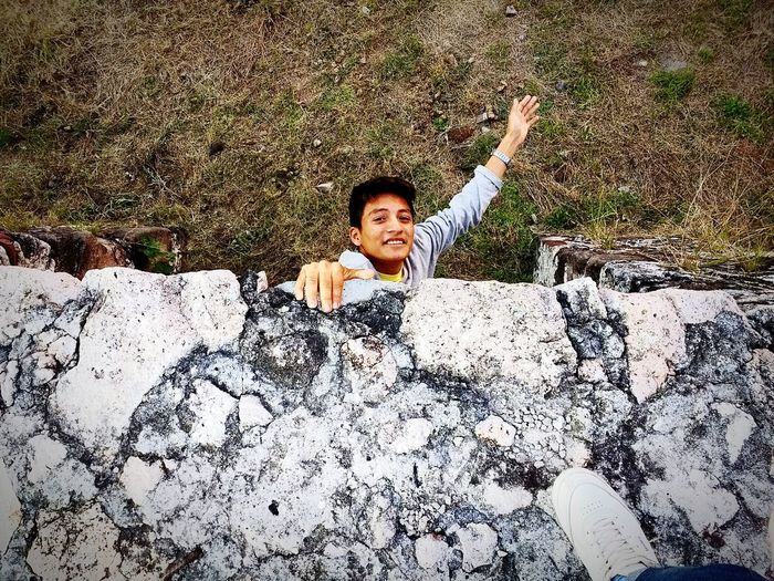 Enjoy The New Normal Hello my friends Happiness Smiling Portrait Arms Raised Looking At Camera High Angle View Human Arm One Person Adults Only Enjoyment Leisure Activity Cheerful Young Adult Outdoors Day Full Length Adult Freshness People One Man Only