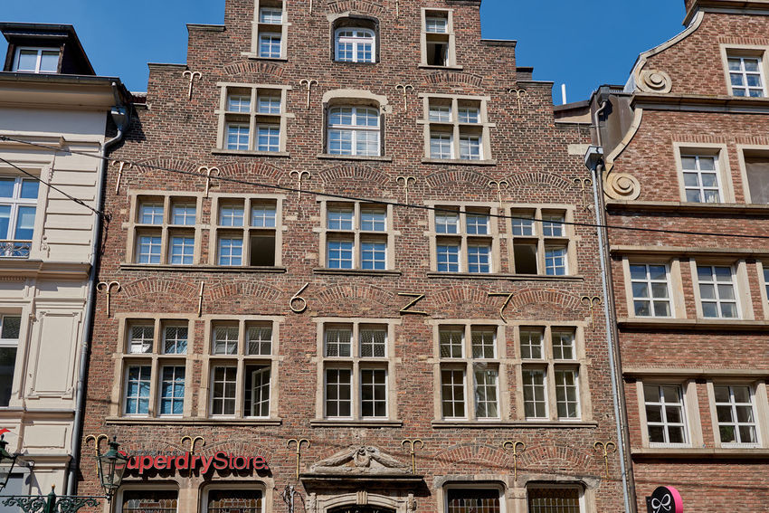 DUESSELDIRF, GERMANY - AUGUST 17, 2016: The fascade of an old building from 1617 shows the typical Rhine area stepped roof Alstd Colorful Diversity Düsseldorf High Resolution Lifestyle People Rheine Shopping Tourism Travel Turis Destina Walking Around Water