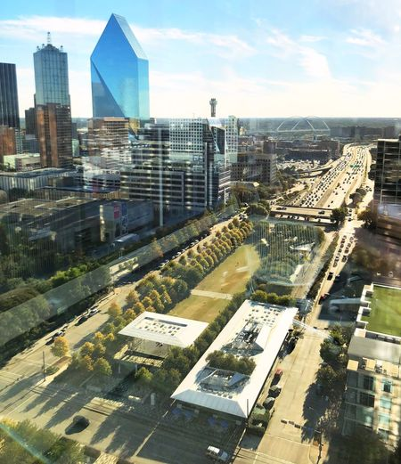 A Park in Downtown Dallas, Tx Dallas Urban Skyline Urban Landscape Blue Color High Angle View Day Tower No People Financial District  Modern Residential District Architecture Cityscape City Downtown District Afternoon Light Lush Foliage Business Finance And Industry Business Building Exterior Skyscraper Outdoors Copy Space Futuristic Downtown