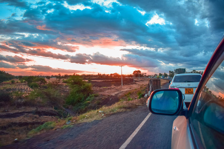 road trip Africa Kenya Sunset Road Rural Scene Car Red Road Trip Dramatic Sky Driving Sky Cloud - Sky First Eyeem Photo