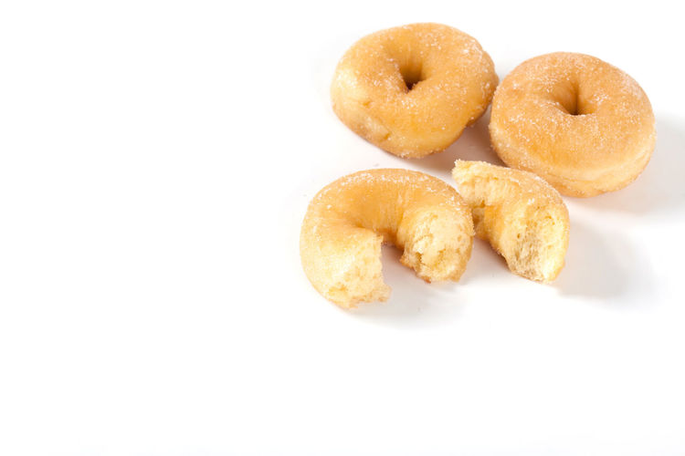 Background Baked Bakery Bitten Breakfast Brown Bun Cake Calories Circle Closeup Delicious Dessert Donut Donuts Dough Eat Fat Food Fresh Fried Frosting Glazed Gold Icing Isolated Junk Pastry Round Snack Sugar Sugary Sweet Tasty Top Treat Unhealthy View White Yellow Yummy