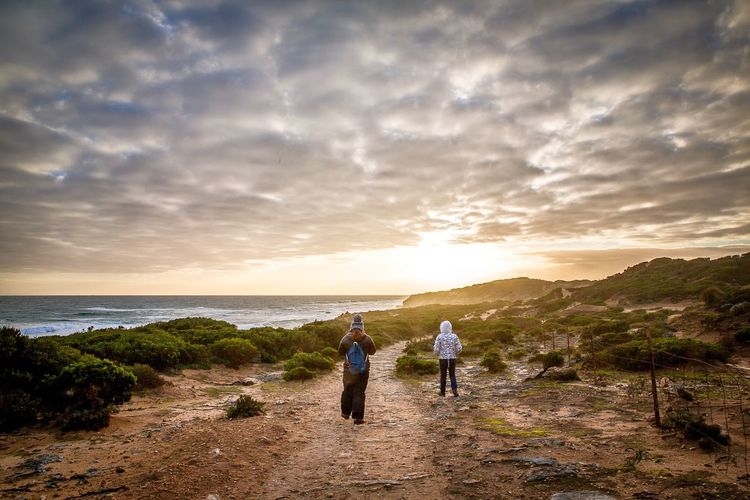Another version Check This Out Hanging Out Walk Tranquility Tranquil Scene Sunset Sky Shore Sea People Of The Oceans Hiking Coastline Cloudy Beachside Feel The Journey Original Experiences 43 Golden Moments Showcase June On The Way Lost In The Landscape