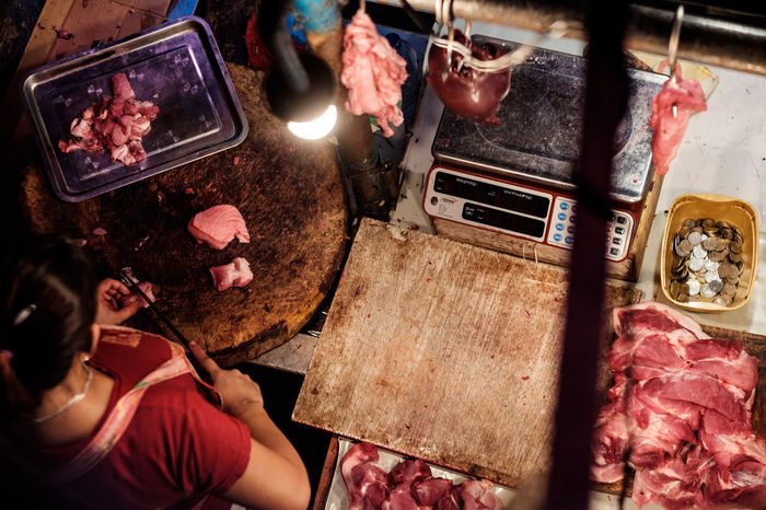 Night Real People Indoors  One Person Human Body Part People Butcher Meat Shop Market Birds Eye View Top View Top Red Raw Work Working Workplace Food Stories
