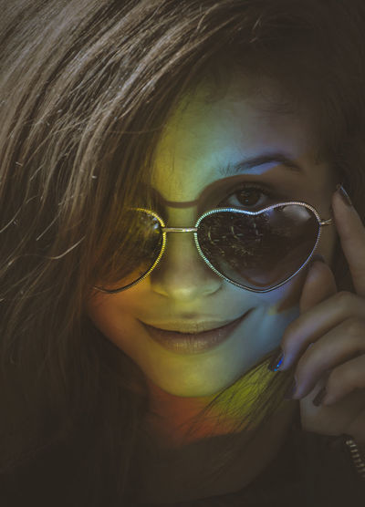 Close-up portrait of girl wearing sunglasses