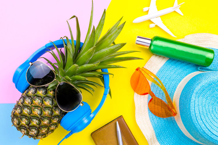 Directly above shot of summer equipment on colored background