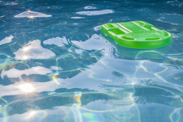 High angle view of pool raft on swimming pool