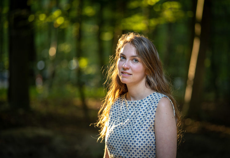 Portrait of beautiful young woman at park