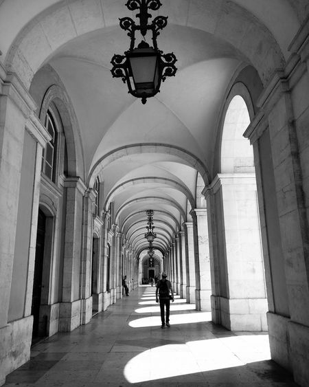 A moment of silence in a busy lisbon city centre Arch Architecture Indoors  Full Length One Person Walking The Way Forward History People Lifestyles Adult Built Structure Day City Lisbon Lisbon City Life Lisboa Portugal Lisbonlife Lisbona Break The Mold The Street Photographer - 2017 EyeEm Awards