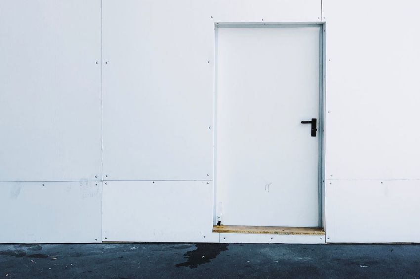 Minimalism Urban Geometry Urban Urbanphotography Urban Exploration Streetphotography EyeEm Selects Door Entrance Closed Built Structure Architecture Building Exterior White Color No People Protection Day Security Safety Building Outdoors Wood - Material White Full Frame Lock Privacy Wall - Building Feature