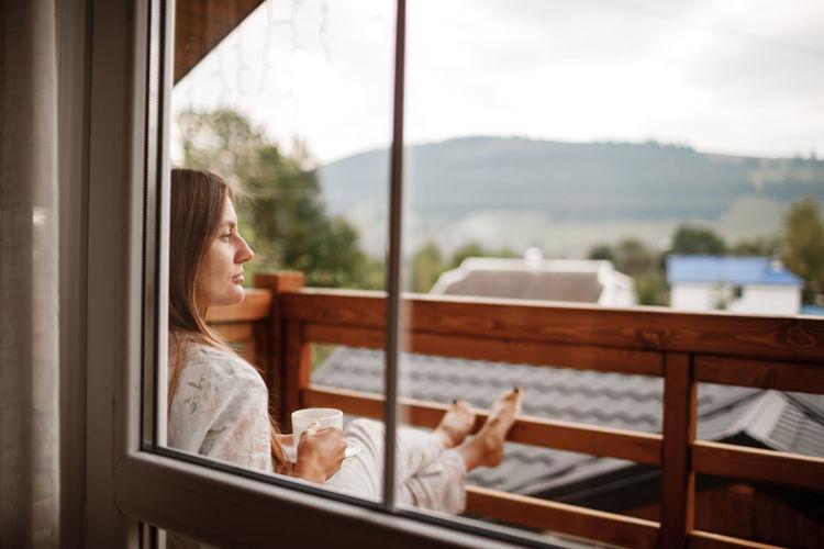 Woman relaxing in balcony