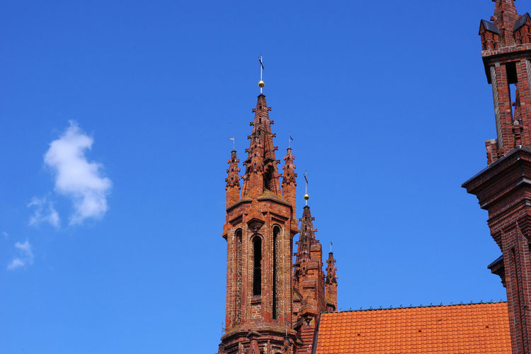 Low angle view of traditional building against blue sky