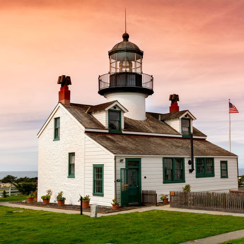 Point Pinos Lighthouse , the oldest continually operating lighthouse on the West Coast, in the sunrise Point Pinos Lighthouse Architecture Building Exterior Built Structure Building House Sky Grass Cloud - Sky Nature Tower No People Outdoors Plant Window Sunset The Past Lawn History Day Sun Historical Tourist Attraction