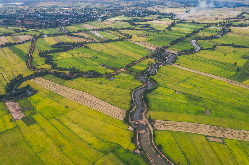 aerial view of road and devious river in a fields Landscape Environment Field Rural Scene Aerial View Agriculture Scenics - Nature Land Farm Patchwork Landscape Tranquil Scene Growth Beauty In Nature Nature Green Color Non-urban Scene Day Plant Tranquility Outdoors River Water Green Color Growth Nature Natural ASIA Asian  Countryside Top View Rice Paddy Rice Field Paddy Field Drone  Mavic 2 Pro