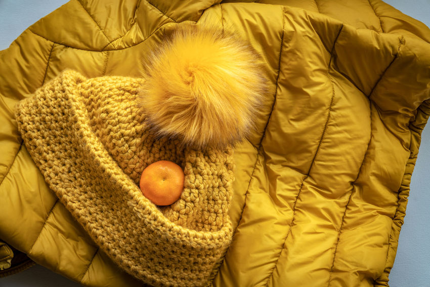 Warm Clothing Clothing Hat Vitamin C Vitamin Orange Partner Collection The EyeEm Collection Clothing Warm Clothing Yellow Indoors  Furniture Winter Leisure Activity Textile Comfortable Jacket Lifestyles Relaxation Close-up High Angle View Hood - Clothing Cold Temperature Cold Hat Cap Bobble Orange Winter