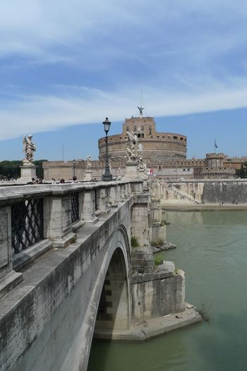 Ponte sant angelo over tiber river by hadrian tomb against sky