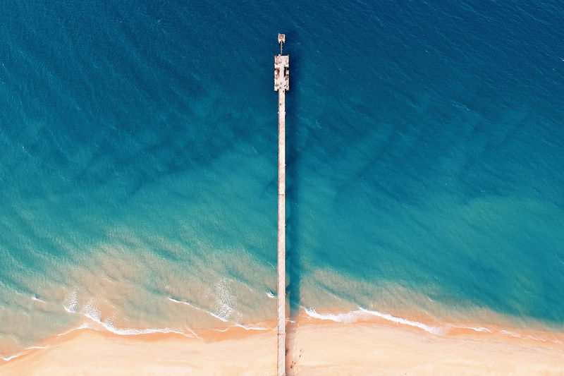 Aerial View Beach Beauty In Nature Blue Day High Angle View Land Motion Nature No People Outdoors Scenics - Nature Sea Sport Sunlight Swimming Pool Tranquil Scene Tranquility Turquoise Colored Water