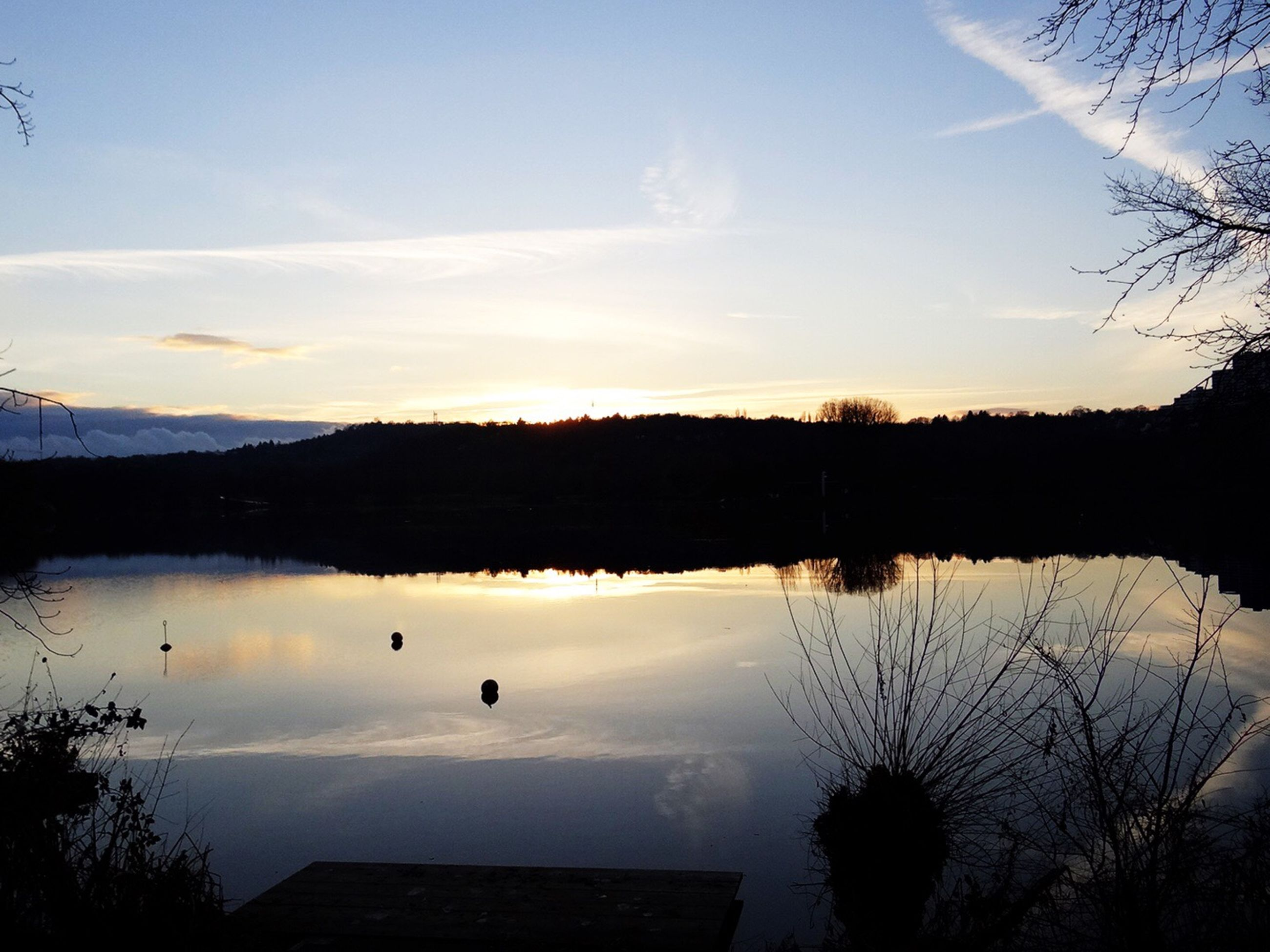 sky, nature, reflection, beauty in nature, water, lake, sunset, scenics, tranquility, silhouette, idyllic, outdoors, tranquil scene, no people, landscape, tree, animal themes, day