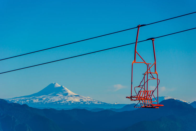 Llaima volcano... Winter Snow Electricity  Connection Fuel And Power Generation Low Angle View Day Cable Technology Beauty In Nature Scenics - Nature Mountain Range No People Mountain Sky Mountain Peak Snowcapped Mountain Outdoors Power Line  Blue Nature Cold Temperature Power Supply Scenics Aroundtheworld